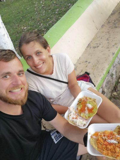 Eating street food in Flores - great to lower your Guatemala travel budget