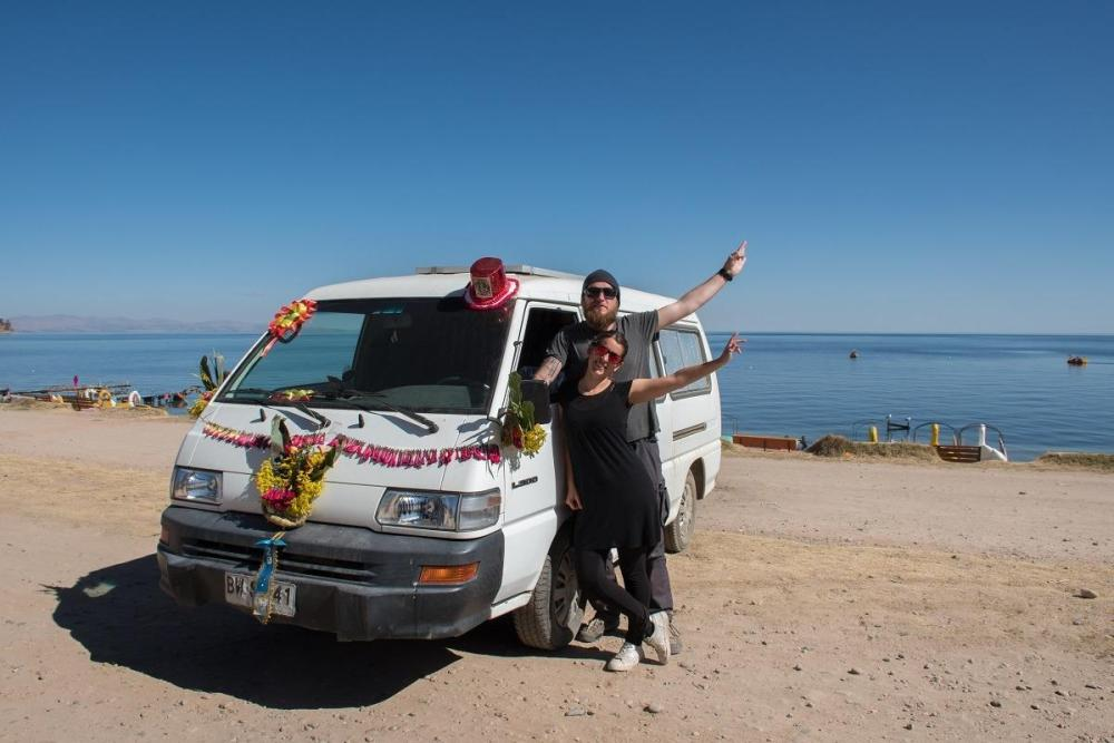 Us and our decorated van by the lake Titicaca in Bolivia