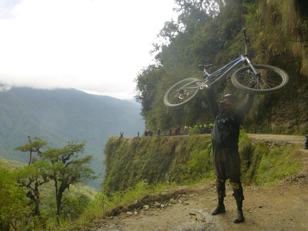 Bojan holding his bike on a Death Road Bolivia