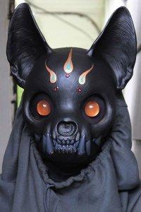A black cat skull mask.