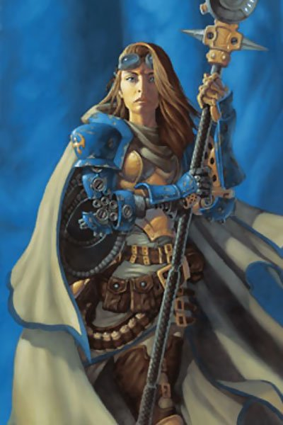 A woman with long blond hair wearing blue armor stands