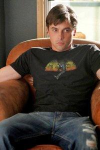 Jake (Skeet Ulrich) sits frowning.