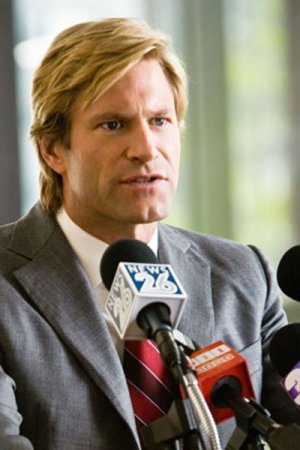 Aaron Eckhart as Harvey Dent.