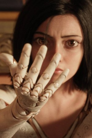 Rosa Salazar as Alita studies her new hand.
