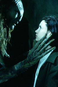 Ofelia (Ivana Baquero) confronts the faun (Doug Jones).