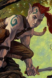 A tattooed elfin man crouches in the trees.