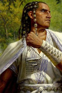 A man with long dark hair and white robes stands defiantly.