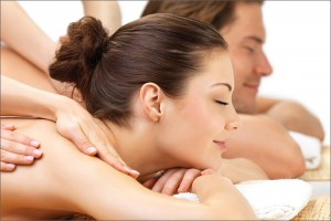 Man and woman getting a couples' massage at Blue Mountain Mist Massage