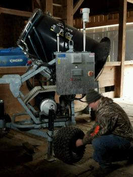 Dizzle repairing tire on mobile fan gun.