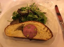 Sausage with pistachios in brioche