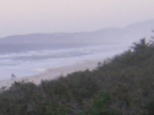 The wind whipping up the salt spray Coolum hidden in the background .