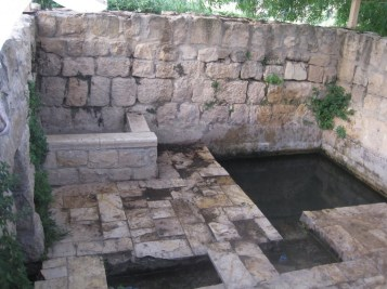 """Mikveh of ancient times.  is a bath used for the purpose of ritual immersion in Judaism. The word """"mikveh"""", as used in the Hebrew Bible, literally means a """"collection"""" – generally, a collection of water.[3] Several biblical regulations specify that full immersion in water is required to regain ritual purity after ritually impure incidents have occurred. A person was required to be ritually pure in order to enter the Temple. In addition, a convert to Judaism is required to immerse in a mikveh as part of the his/her conversion, and a woman is required to immerse in a mikveh after her menstrual period or childbirth before she and her husband can resume marital relations."""