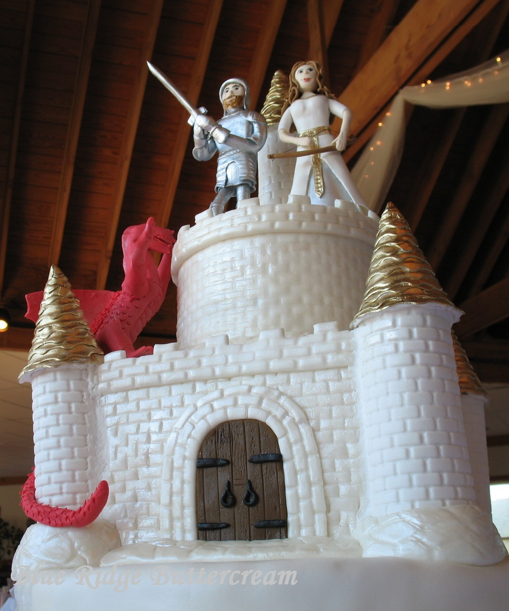 Castle wedding cake   Blue Ridge Buttercream Dragon Castle Cake with Princess and Knight