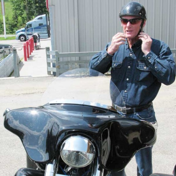 Floyd Town Manager Lance Terpenny and his custom Harley-Davidson Softail -- one of his motorcycles