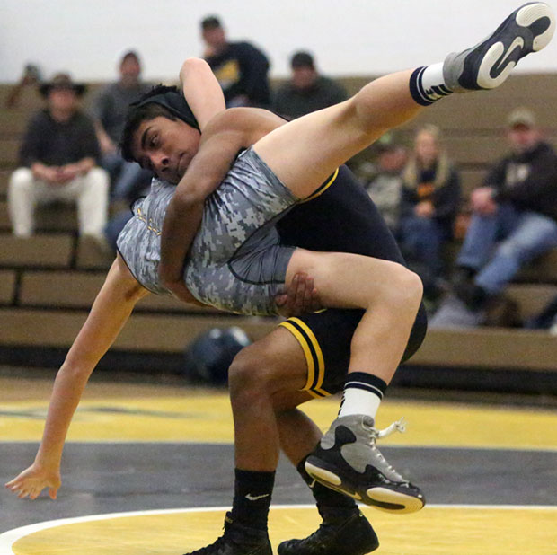 Miguel Policarpo of Floyd takes down an opponent from Grayson County.