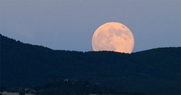 The moon rises on July 13, 2014
