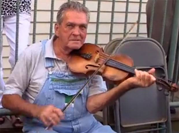 Clyde Williams and his fiddle on the streets of Floyd on Friday night.