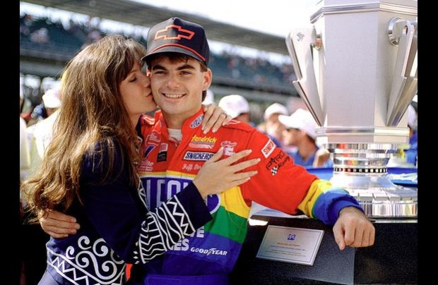 Jeff Gordon at age 23 in 1994 winning the debut Brickyard 400 at Indianapolis Motor Speedway.  Kissing him is his then-fiance Brooke.  She took the money and ran later in a divorce.
