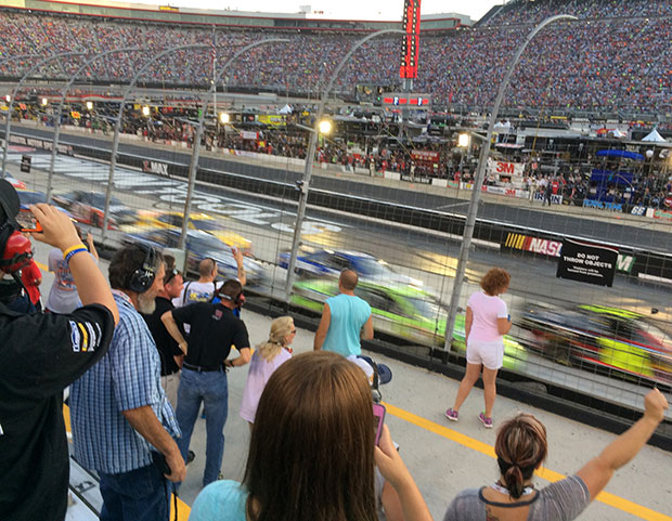 Frans cheer on their drivers at the start of the race Saturday night.