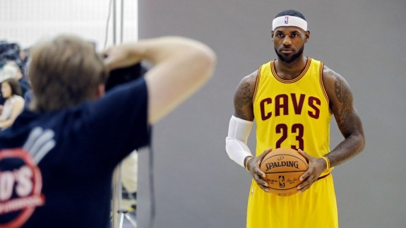 LeBron James poses for Sports Illustrated photographer Al Tielemans, one of six SI photographers laid off. (Photo by Mark Duncan/Associated Press)