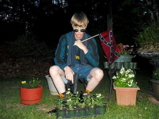 This appeared on Lastrhodesian.com, a website being investigated by the FBI in connection with Charleston, S.C., shooting suspect Dylann Roof, shows Roof posing for a photo while holding a Confederate flag. The website surfaced online Saturday, June 20, 2015, and also contained a hate-filled 2,500-word essay that talks about white supremacy and concludes by saying the author alone will need to take action. (Lastrhodesian.com via AP)