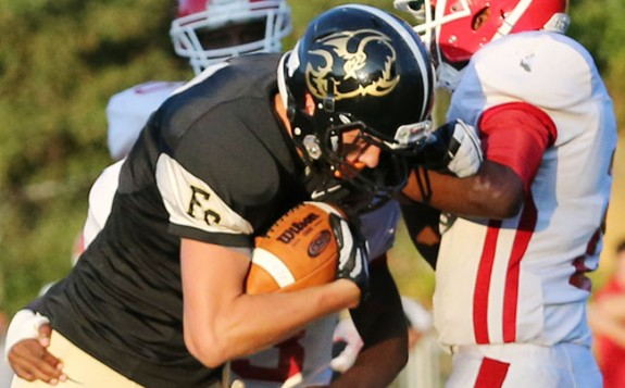 Josh Bary pushes ahead for a first down in the first scoring drive for the Buffaloes. (All photos by Doug Thompson)