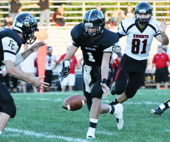 Floyd Quarterback Brady Underwood drops ball before handoff in first series of the game (All photos by Doug Thompson)
