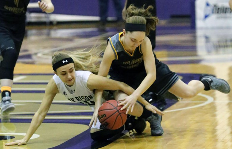 Michaela Thompson fights the Lady Bison for the ball.