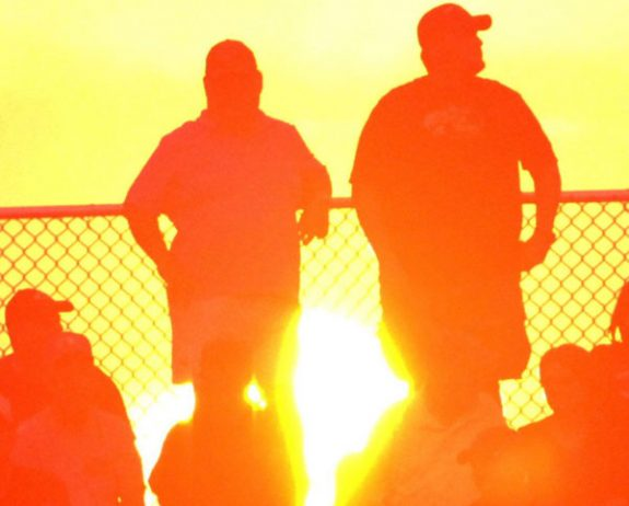 The sun dips behind those gathered at a Floyd County High School athletic event.