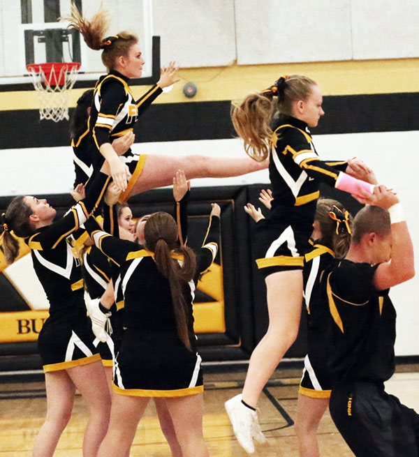 Varsity cheerleaders in action.