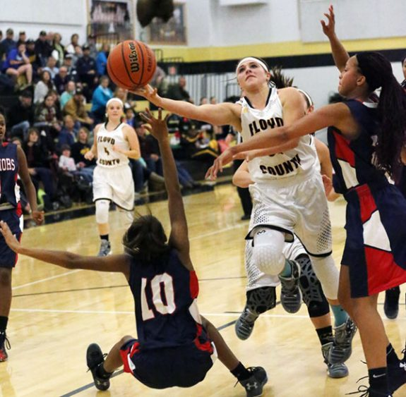 Cassidy Pratt drives for the basket in varsity action.