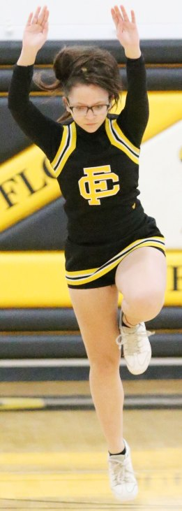 Cheerleader begins a flip.