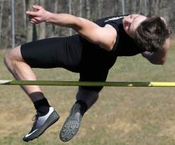 Over the bar in the high jump.