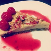 Cashew Cheesecake topped w/raspberry coulee