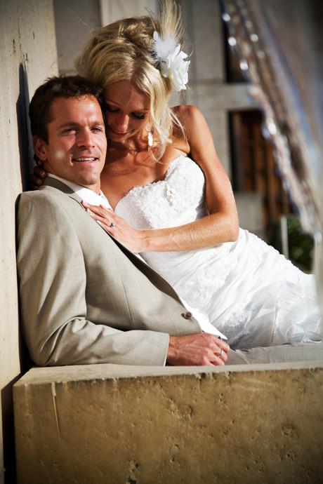 Bride and Groom behind fountain at Salk Institute in La Jolla, San Diego, California