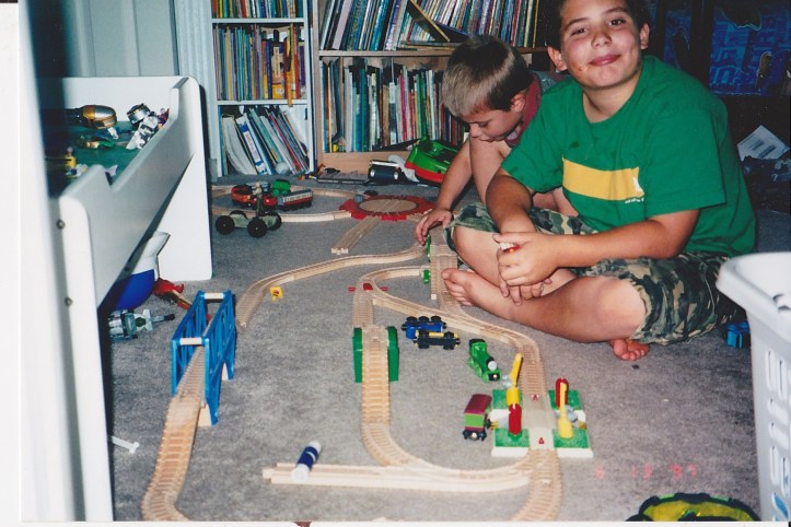 Kids playing with a train set.