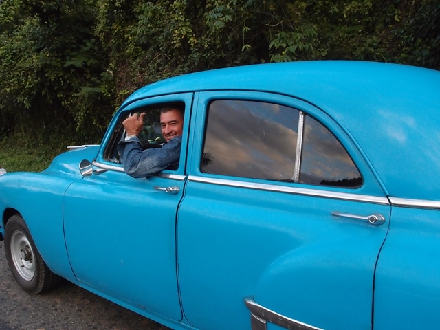 Driver from Cienfuego to Trinidad, Cuba, Blue Sky and Wine