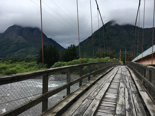 Old flimsy wooden bridge in Pucón, Chile