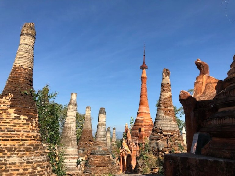 indein stupas inle lake in bricks, blue sky and wine