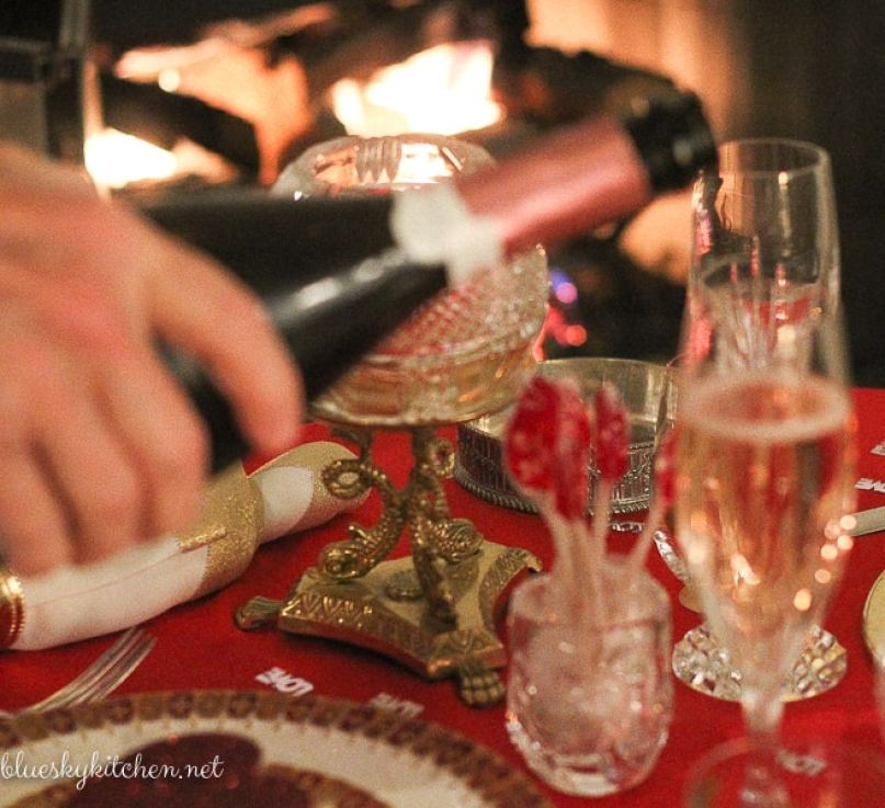 How to Create a Romantic Valentine's Table for Two ~ the fireplace can be the perfect place for a romantic setting with hearts and a glass of Champagne.