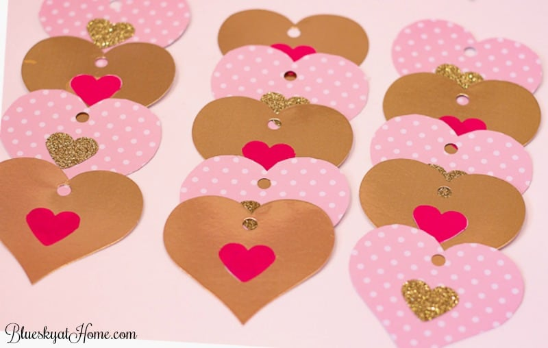 3 Easy DIY Valentine Decorations under $10. These super cute DIY projects are made from the same supplies but look completely different. Make your Valentine's Day special with a front door sign to welcome guests, a heart garland for a fun touch, and handing flowers. BlueskyatHome.com
