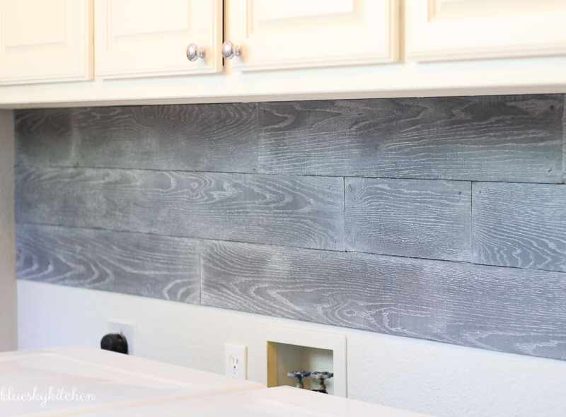 How to Install a Wood Backsplash the Right Way. I'm sharing the do's and don'ts we discovered installing our Palette Wall in a Box in our laundry room.