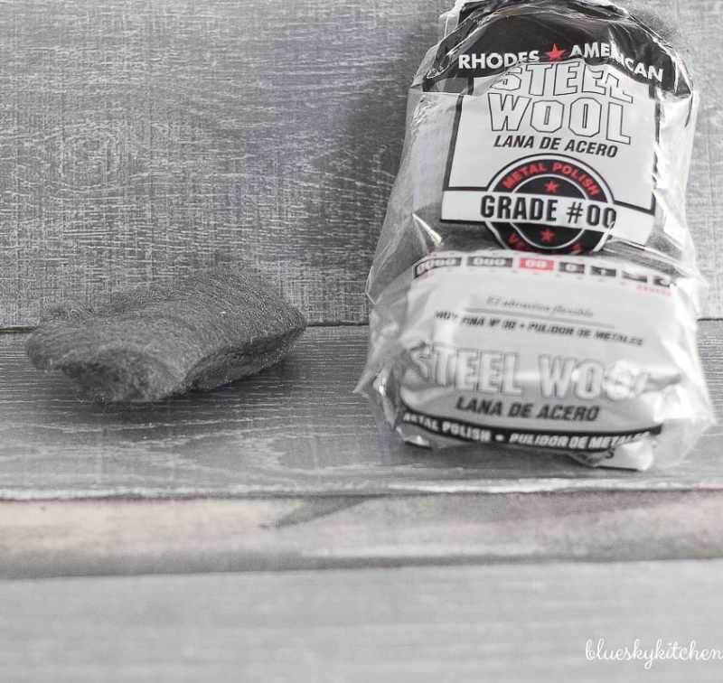 How to Create a Weathered Wood Backsplash. Palette in a Box and Amy Howard at Home products created a weathered looking wall as a backsplash.