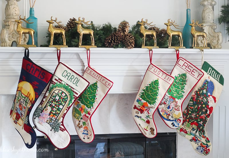 Decorating the Mantle with Lights and Garland for Christmas provides sparkle and magic. Reindeer and stockings add to the festive feel. BlueskyatHome.com