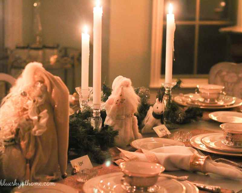 Santas and Reindeer Shine in Christmas Tablescape 2017. Green, gold, silver and white create a soft silhouette for holiday characters. BlueskyatHome.com