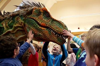 French Holiday Club Children Meet Dinosaur