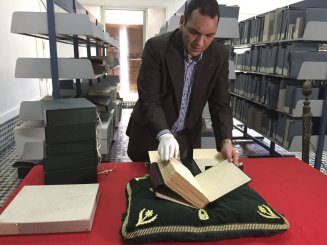 abdelfattah-bougchouf-is-the-curator-of-the-impressive-collection-its-his-responsibility-to-make-sure-the-books-are-cared-for-and-properly-handled