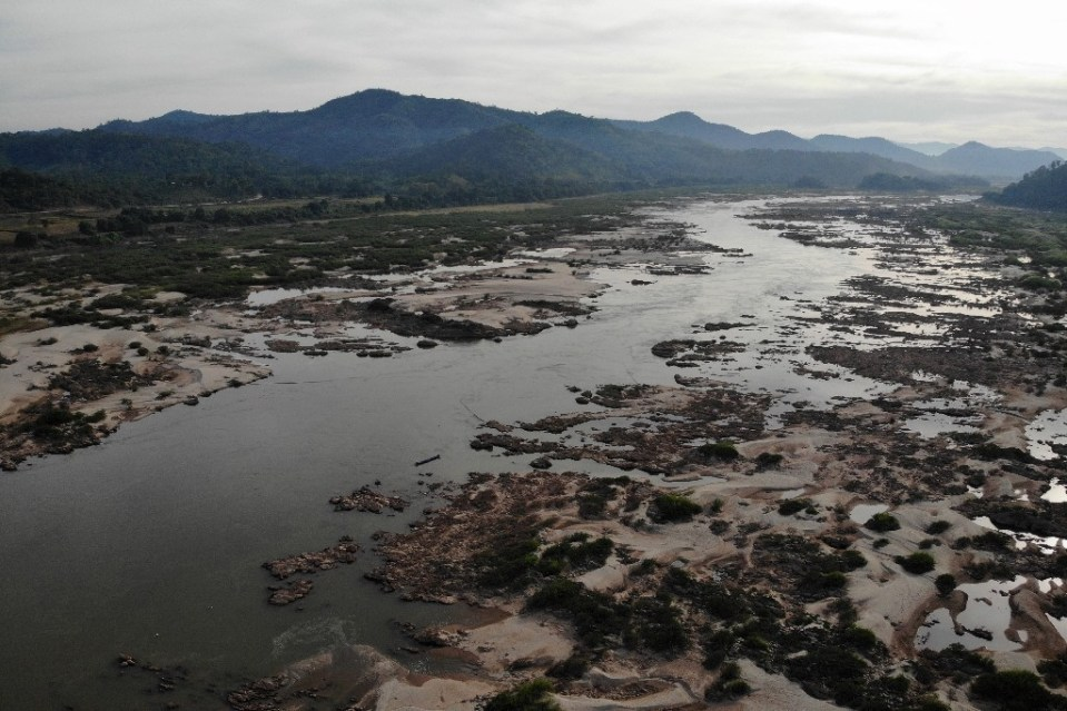 """""""Laos, Thailand, Cambodia and Vietnam all battled severe drought last year as the tide of the Mekong River fell to record lows -- exposing rocks, killing fish and threatening millions of livelihoods - Lillian SUWANRUMPHA / ©AFP"""""""