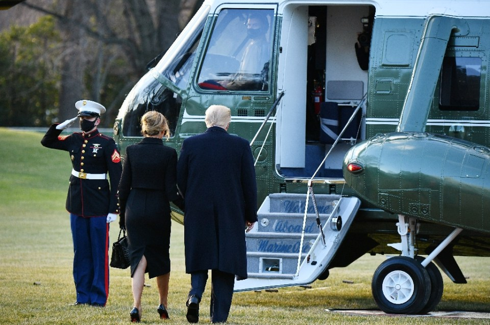 US President Donald Trump and First Lady Melania board Marine One before departing the White House for the last time in Washington, DC on January 20, 2021 - MANDEL NGAN / ©AFP