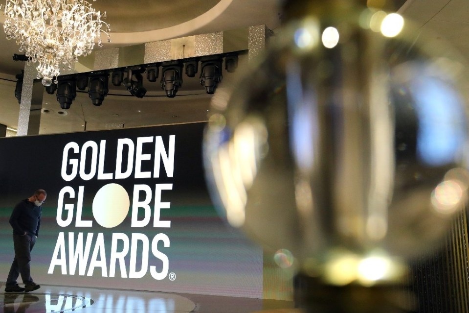 Usually a star-packed, laid-back party that draws Tinseltown's biggest names, this pandemic edition of the Golden Globes will be broadcast from two scaled-down venues in Los Angeles and New York, with frontline and essential workers among the limited few in attendance - Arturo Holmes / ©AFP